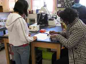 photo of students working in a high school biotechnology lab class
